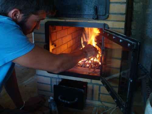 Puerta del fuego y caja de ceniza que regula el aire